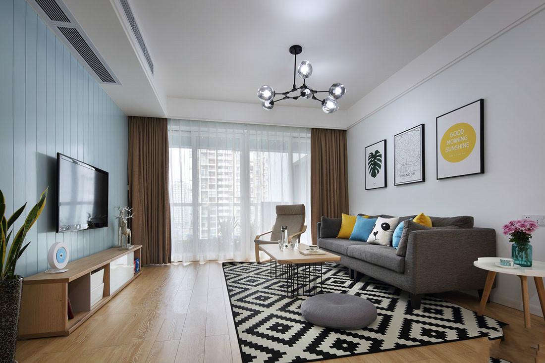 客厅空间干净简洁,精致的吊灯使整个空间亮丽温馨