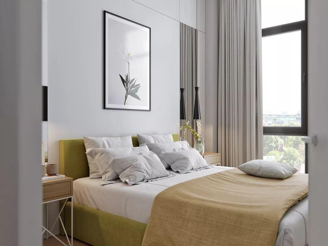 生活区的隔壁是一间卧室。卧室的配色非常舒服,白色主色调搭配木地板再加入绿色点缀,给人洁净舒适的感觉。