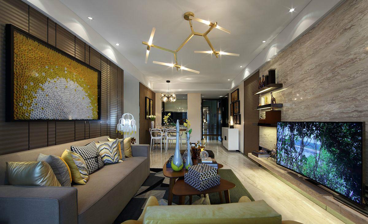 客厅中放置着清晰线条的咖色布面沙发,看上去简洁雅致。