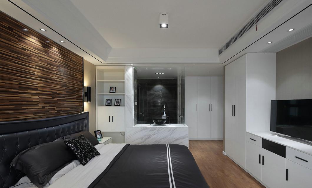 主卧空间没有过多的装饰,用简单的线条,来刻画温馨舒适生活的场景 。