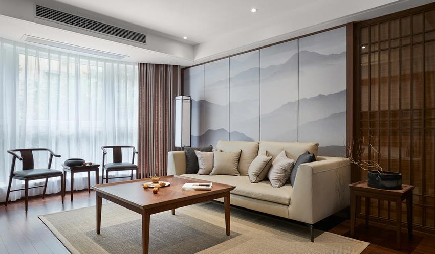连绵不断的山峰水墨画作为沙发背景墙,点亮了整个空间,也定义了主题。