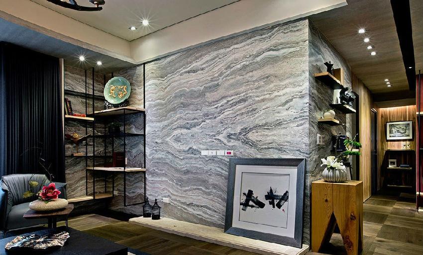 采用仿古面大理石作为电视主墙,并以L型包覆侧边墙面,让空间段落互相串联。