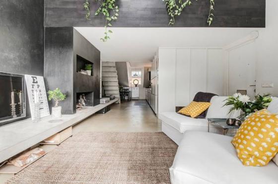 设计师大量运用混凝土和白色调将这里打造的舒适、惬意,充满了生活气息。