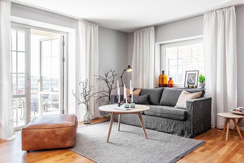 灰色的布艺沙发,绿植的点缀,清新自然,简约装修时尚利落