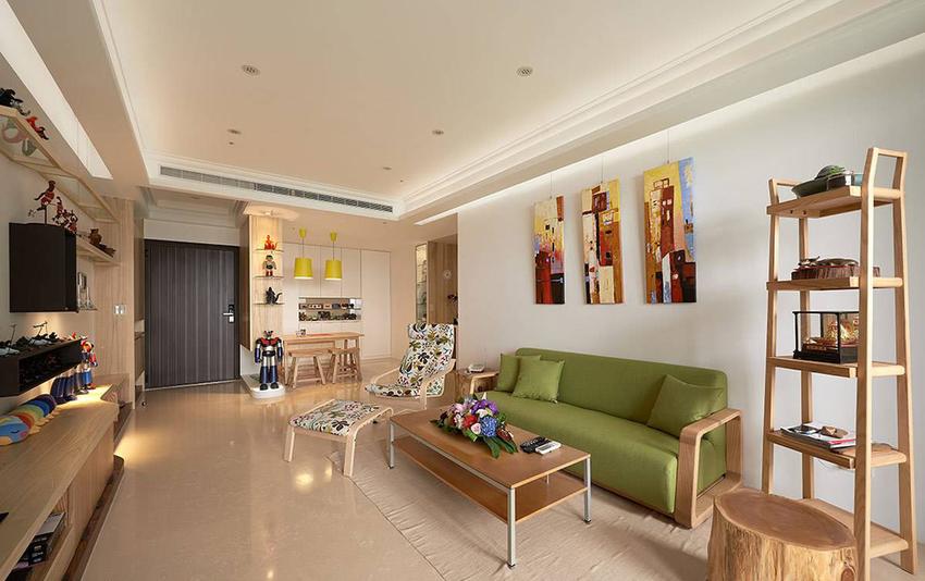 绿色系的沙发,点亮简约白净的空间。