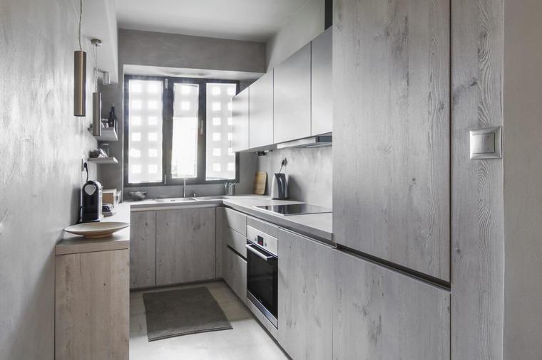 狭长的厨房设计师用混凝土作为主材料。