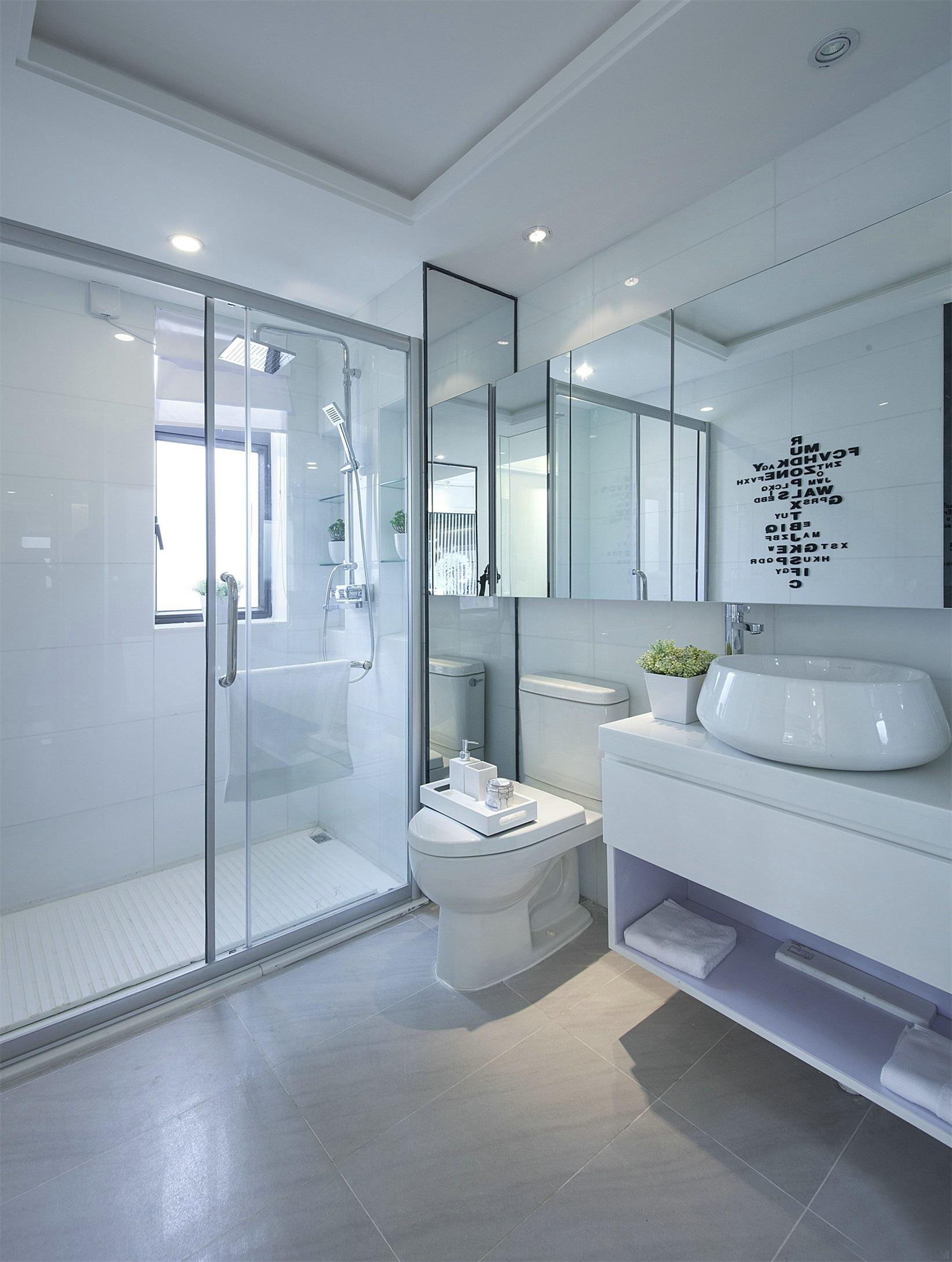 衛生間設計讓空間顯得幹練整潔,硬朗的線條營造出空間的個性,幹濕分離彰顯著空間的層次性。