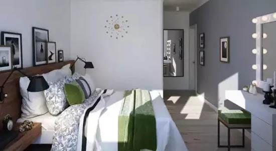 主卧一面墙刷成深灰色,在房君想来,也许是为了着重凸显自带打光效果的梳妆台吧。