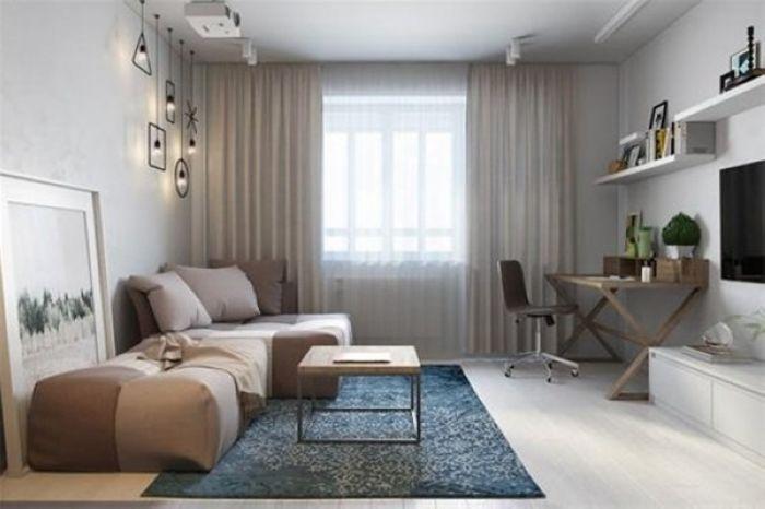 懒人沙发尽是懒意洋洋的柔软感,简约的电视柜搭配挂在墙面的电视设计,木质书桌勾勒出一个工作区。