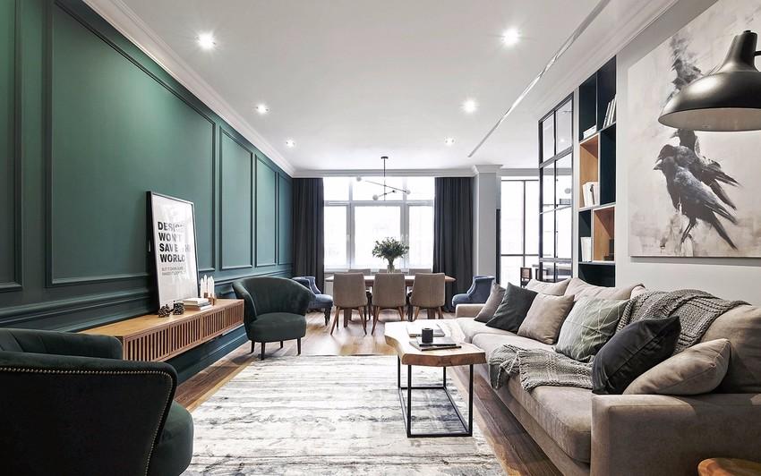 客厅最令人瞩目的必须是墨绿色的电视背景墙,搭配原木色百叶窗电视柜,犹如走在森林深处。
