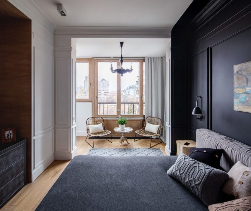 卧室中大胆采用了黑与白还有原木色,强烈的颜色对比。