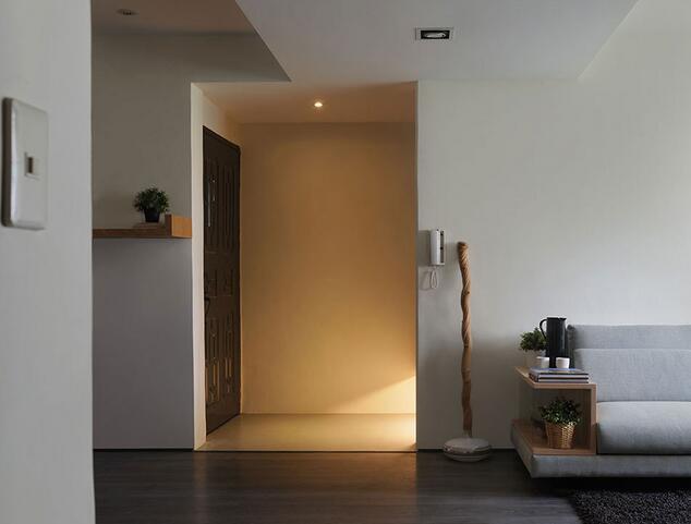利落的动线转圜,透过玄关地坪材质稍加变异,即定义了玄关的独立意义。