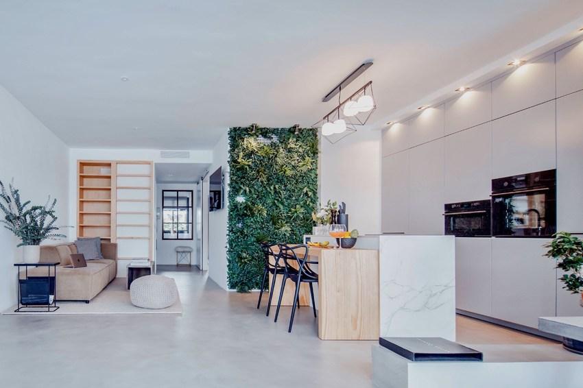 客厅是集中式开放的区域,这是现代风格的特点,开放式厨房与客餐厅在一起,生活的主要区域都集中于此。