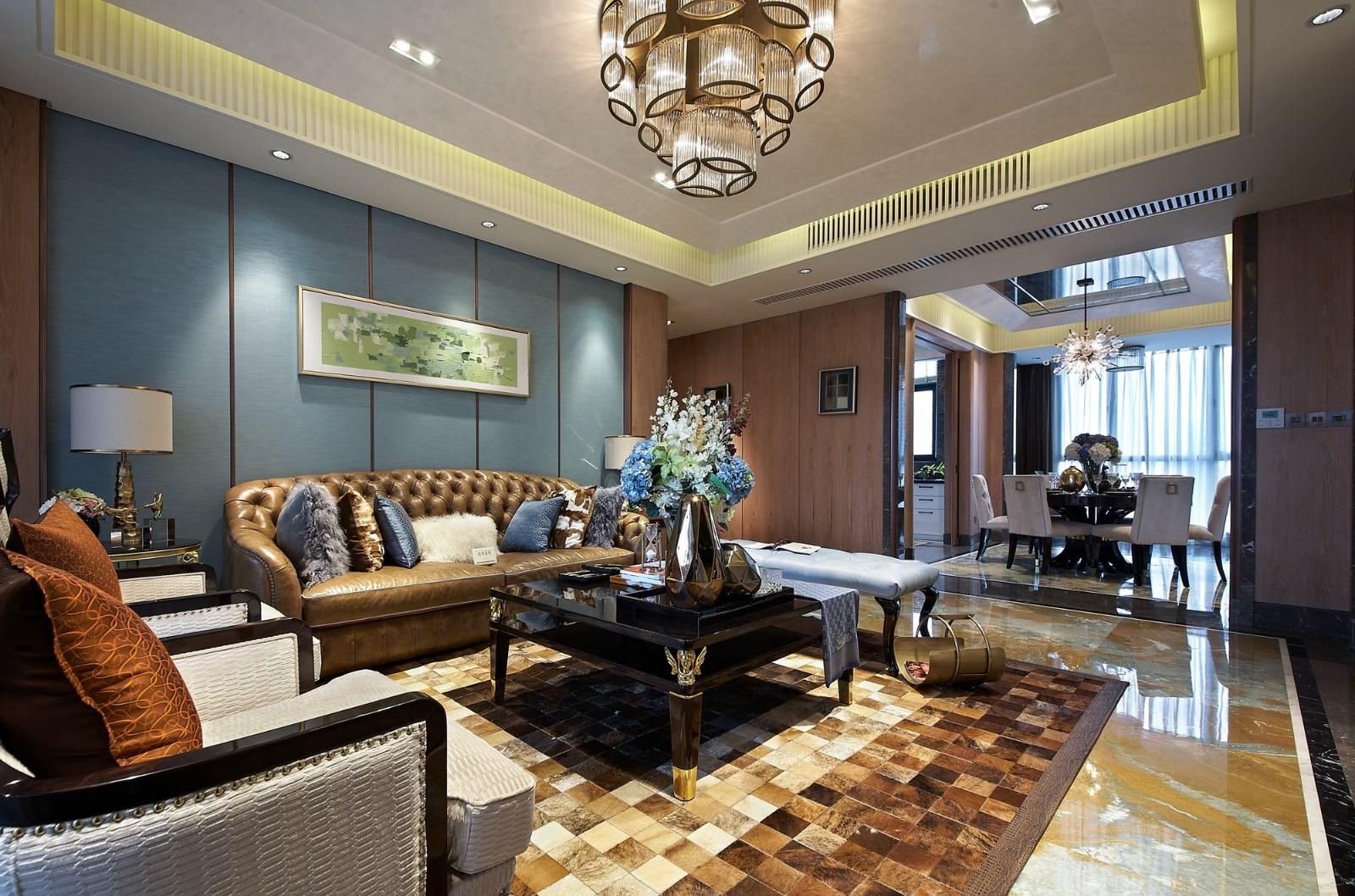 淡蓝色的背影墙尽显优雅生活品质,方格地毯从白色、奶咖到深棕,色调的渐变给人很强的节奏感和审美情趣。