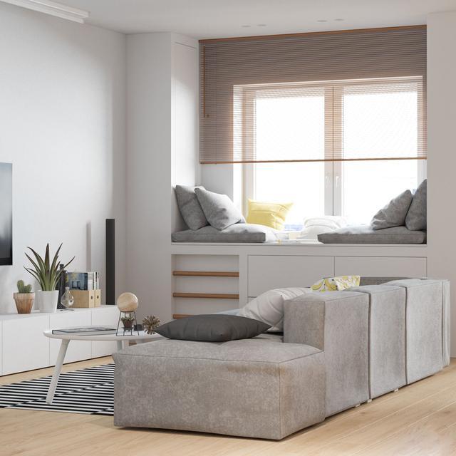飘窗的设计缓解了客厅的储物压力,铺上软垫后这里变得更舒适和温暖。