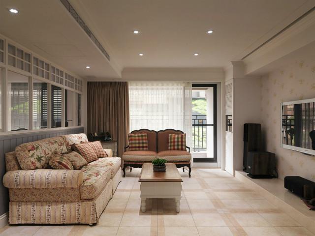 客厅典雅大方,碎花布艺沙发与格子抱枕的搭配,给人一种山野郊区的烂漫感觉。