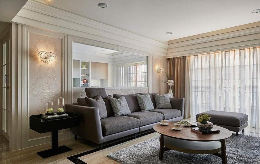 地毯下依照屋主所需,在圆形茶几下方安排相同造型地砖,可随时变换居家氛围。