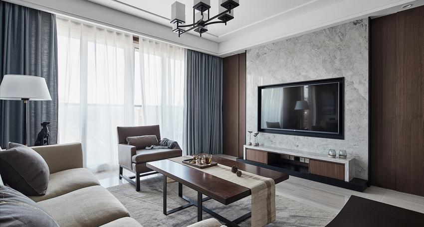 在配色上,大面积的素雅米色墙纸结合静谧的胡桃木饰面,低调时尚的灰色石材,带来安宁的生活氛围。
