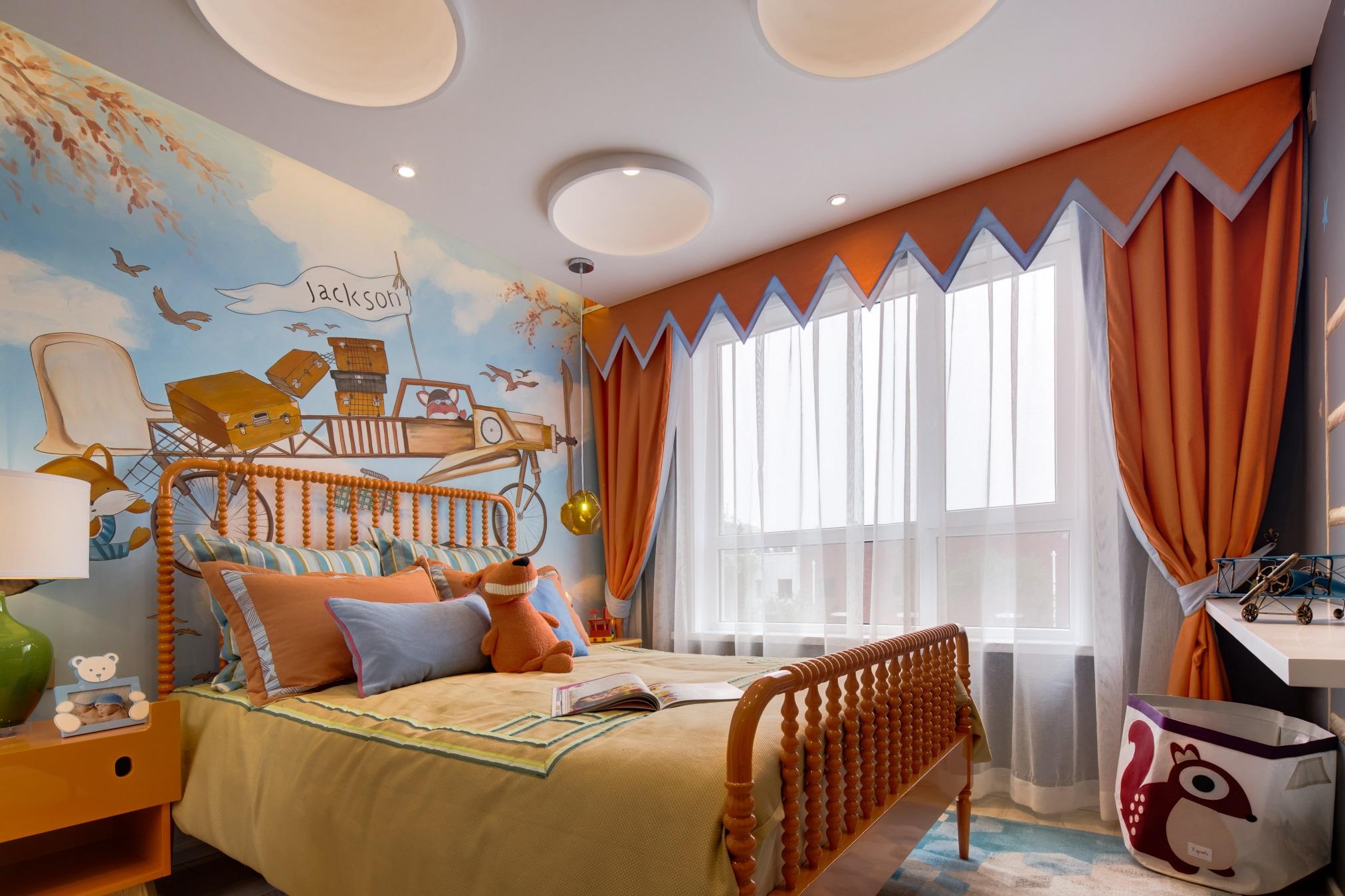 儿童房以浓郁的橘色打造,童趣精致,背景墙是最抢眼的装饰,增添空空间艺术氛围。