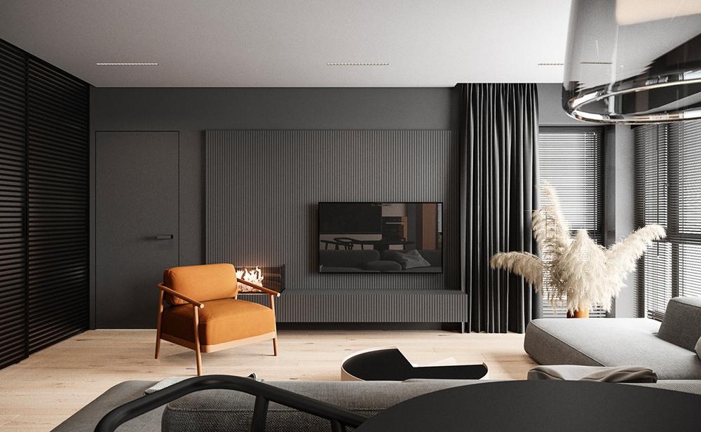 电视机背景墙色调简洁大气,没有丝毫多余的累赘,局部橘色单人椅点缀,充满了生活的气息。