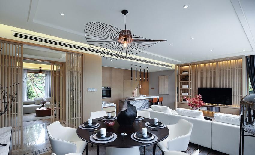 客厅与餐厅的吊灯姿态轻盈,曲线轮廓与平直硬朗的空间背景相得益彰,暗合天圆地方的禅定哲学。