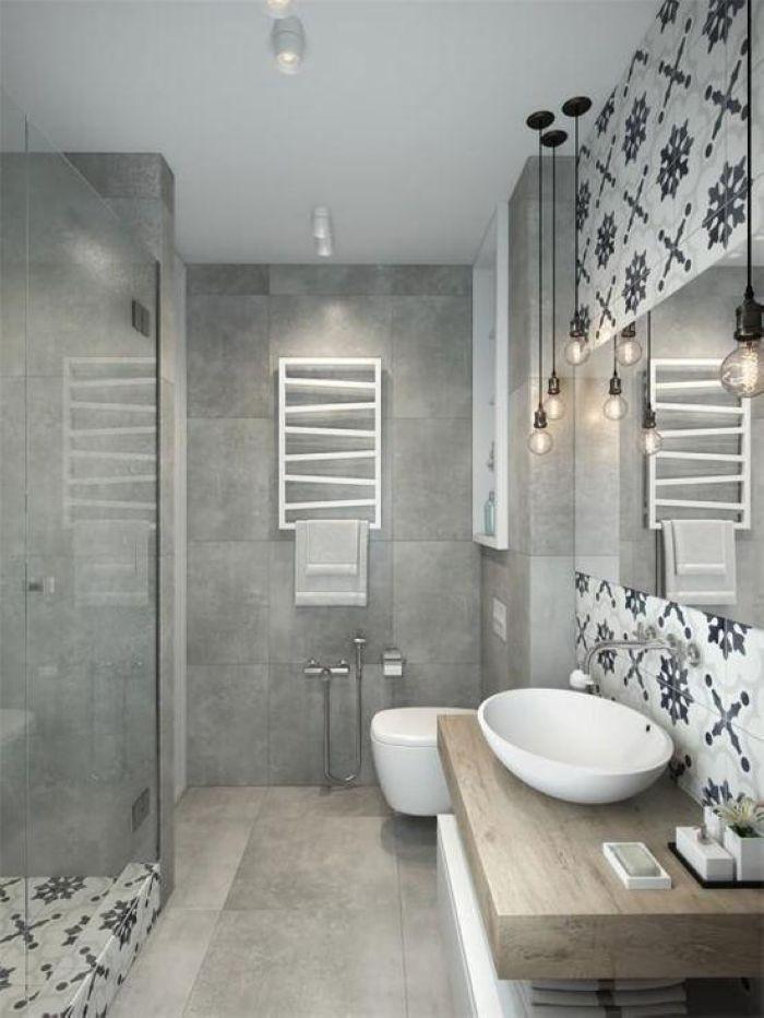 吊灯等错落照明的方式既简约,又展现了居室的个性,仿混凝土色的瓷砖很清冷,干湿分离使用起来很舒服。