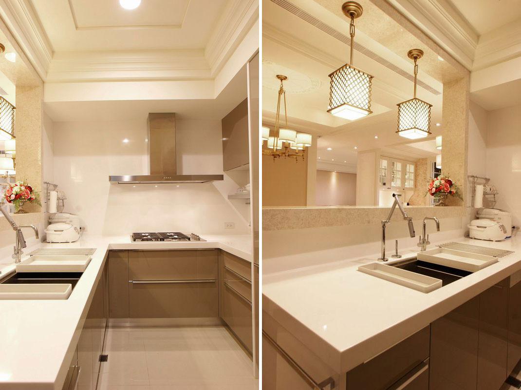厨房简单的大白墙与浅色橱柜,让空间更为宽敞,造型奇特的吊灯为单调的厨房带来些许美感。