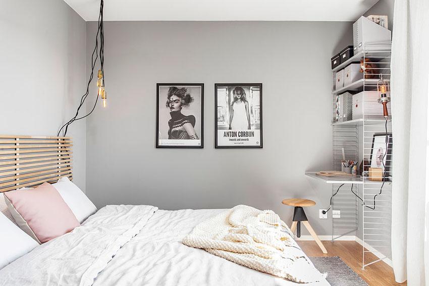 卧室整体颜色搭配很是简单,墙上的挂画很是时尚