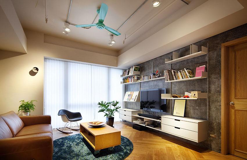 电视背景墙没有任何装饰,突出功能性,简洁多变的组合,客厅也可以看书了。