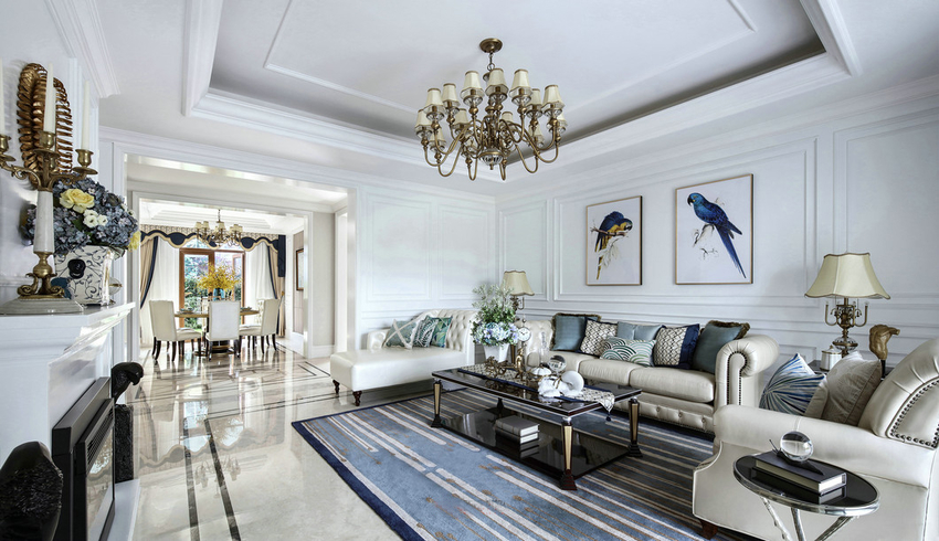 在硬装中线条较多,软装方面大量使用铜色,软饰方面蓝色与金黄色穿插,整体干净,充满贵族的高雅气质。