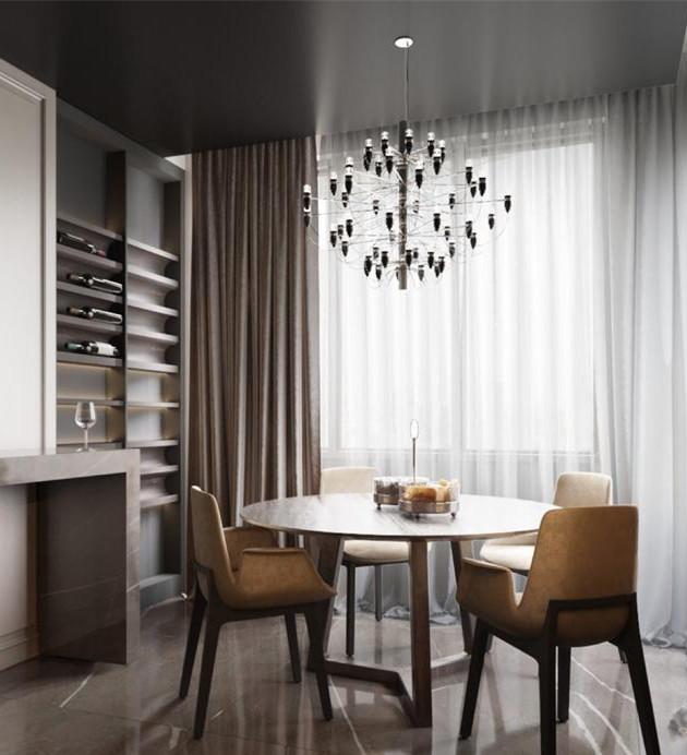 吧椅采用原木风格,延续了整体屋子的装修风格。餐厅用了一个原木色的圆桌,桌边边特意做了酒柜。