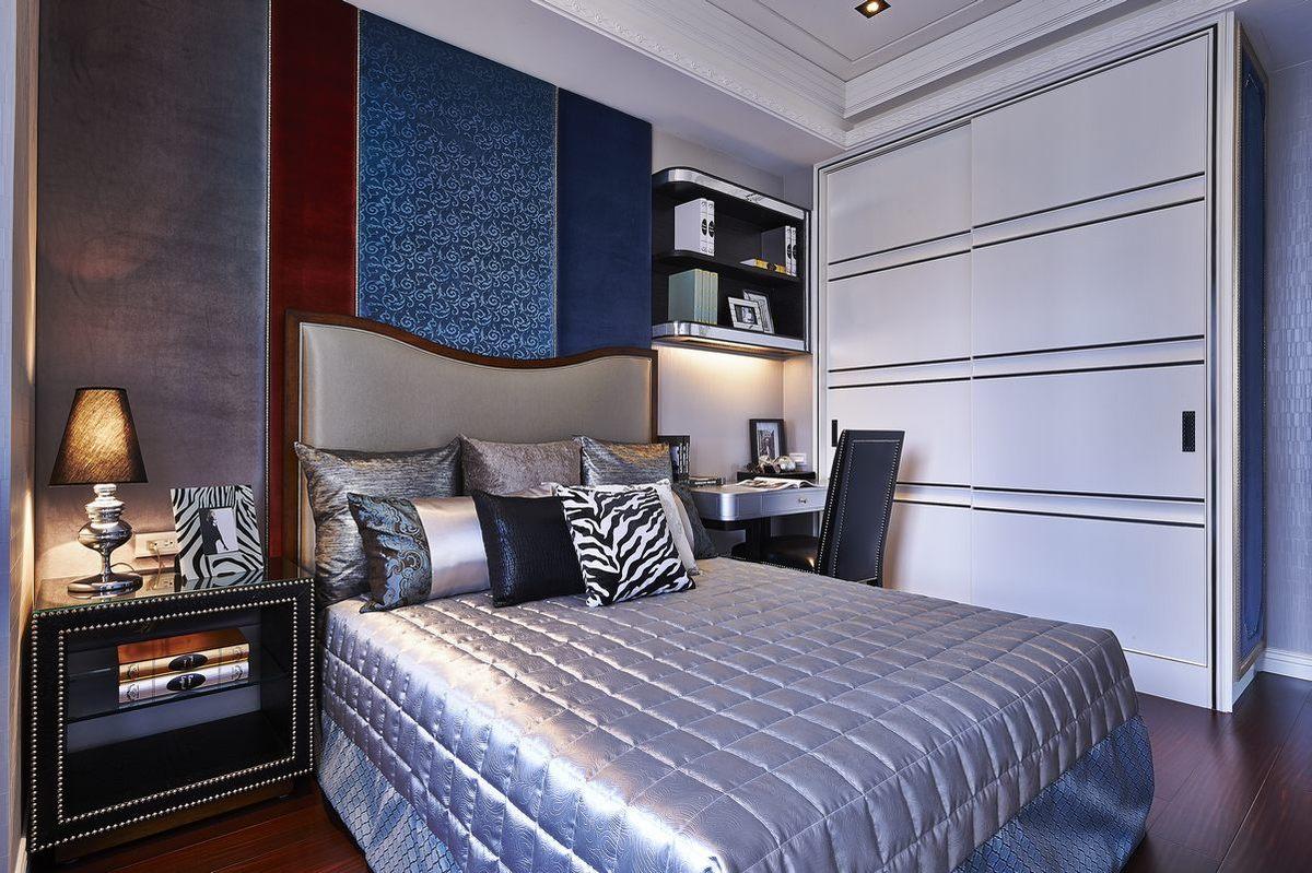 次卧整体简朴,雅致,空间中加以蓝色为点缀,为空间增加了优雅的气氛。