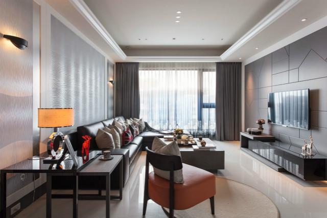 整个空间采用黑白灰相应交替,橘色座椅的置入为整个空间带一丝暖意。