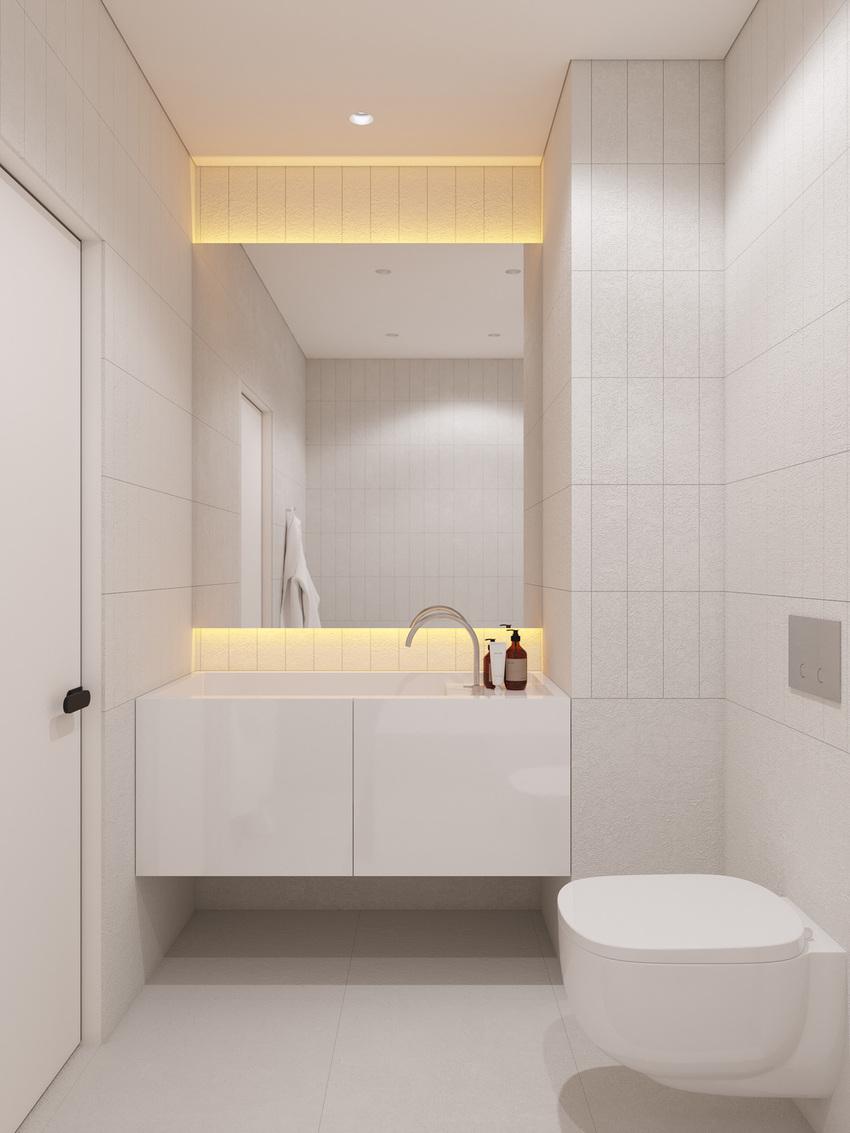 白色瓷砖的浴室还没有嵌入式照明用于增添温馨的情调。