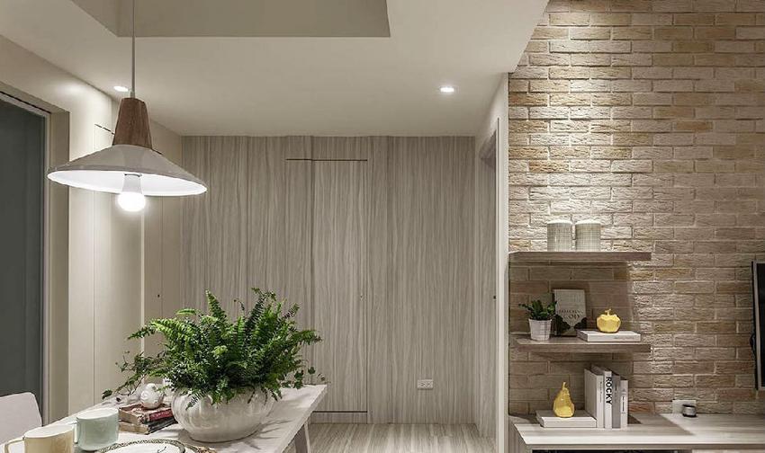立面采用不同质材和造型,创造出丰富层次效果。结合勾缝和暗门设计,淡化空间的入口动线。