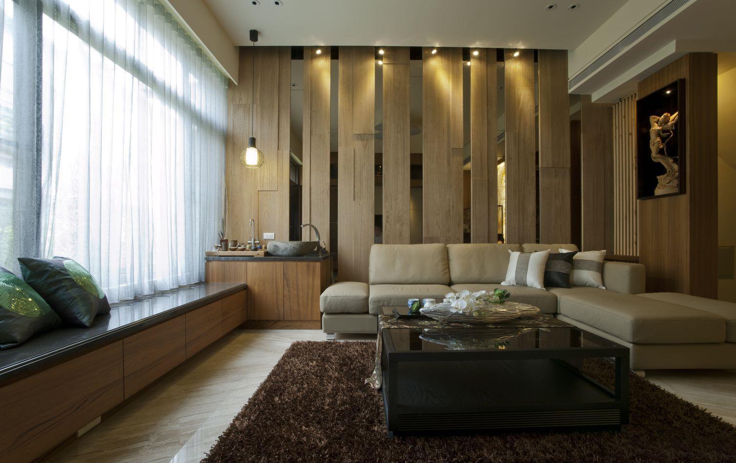 沙发侧面吊灯也很特别,上面可以摆放茶具杯,很有创意,又很时尚。