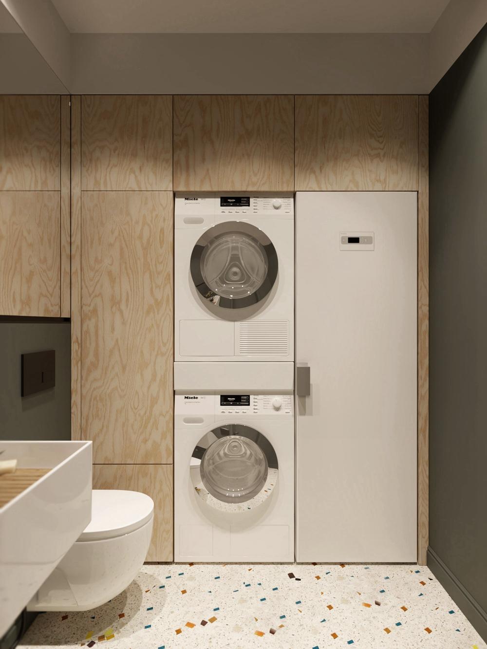 在衛生間內打造洗衣房,簡約且務實的空間設計,提升了生活的效率。