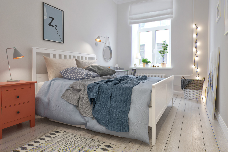 卧室整体干净整洁,浅色系的木质地板,显得整个屋内清新亮丽