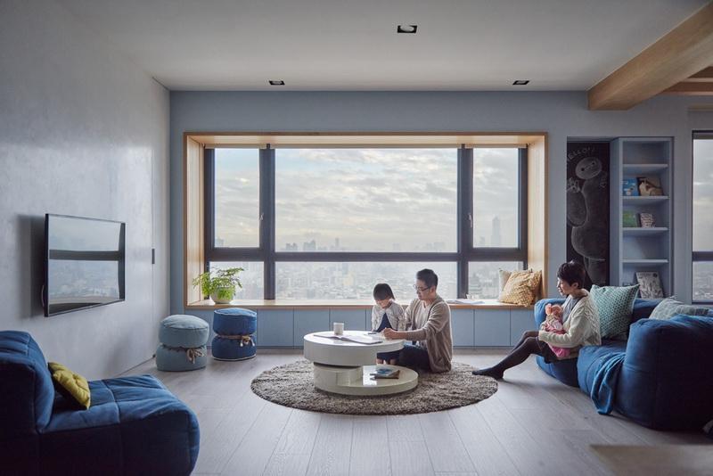 客厅和厨房作为整个空间的中心,用木质地板带来温润舒适。