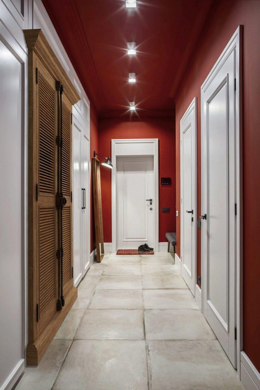 玄关的地方通过红与白的颜色带有一股喜庆的味道,还有着红砖白墙的复古气息。