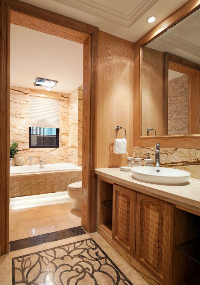 卫生间采用干湿分区,空间大量的原木色家具使用,让自然的感觉融入到房间的点点滴滴。