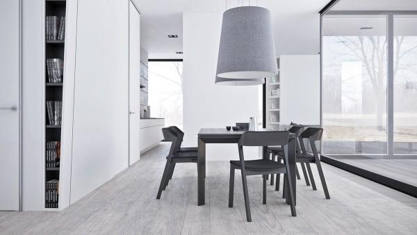 餐厅的线条和布置非常简单,一点摆设也没有,单靠桌椅和灯来突出风格。