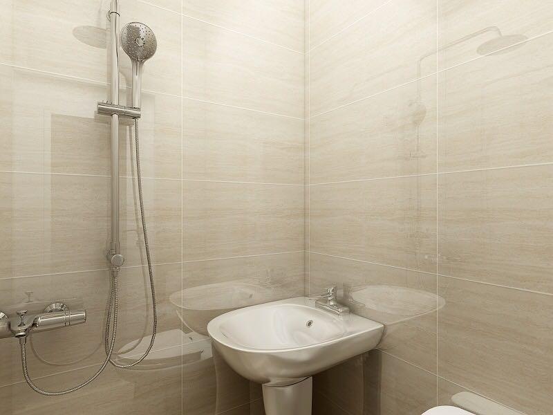 卫生间因为有承重墙无法拆除,所以使用了柱盆,浅色墙砖让整个空间干净明亮。