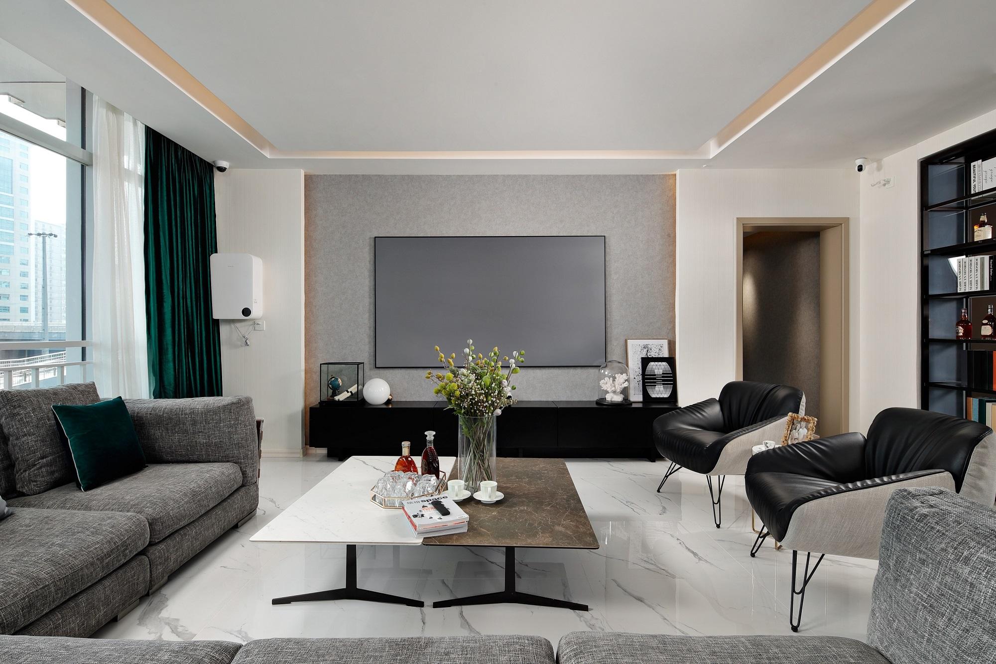 """客厅基调给人简洁、淡雅的感觉,轻奢风十分注重运用高级感的中性色来演绎""""低调的奢华""""。"""