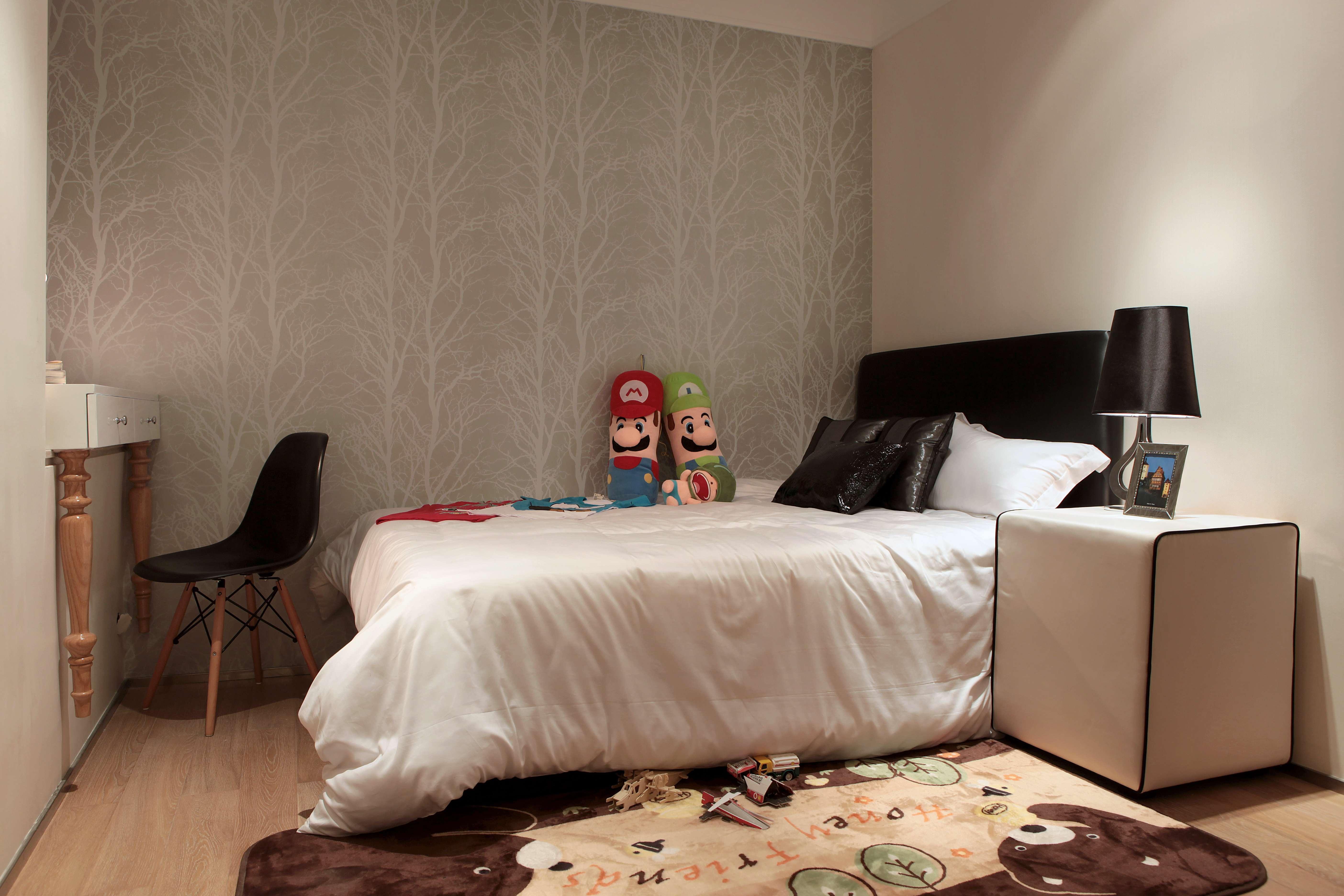 次卧留作儿童房,铺上柔软的卡通地毯,十分温馨。