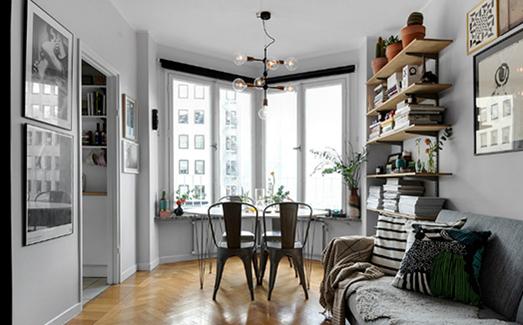 空间整体色调选择了灰色和白色,看起来低调内敛又不显压抑,同时注入适当的木色,带出自然和休憩的氛围。