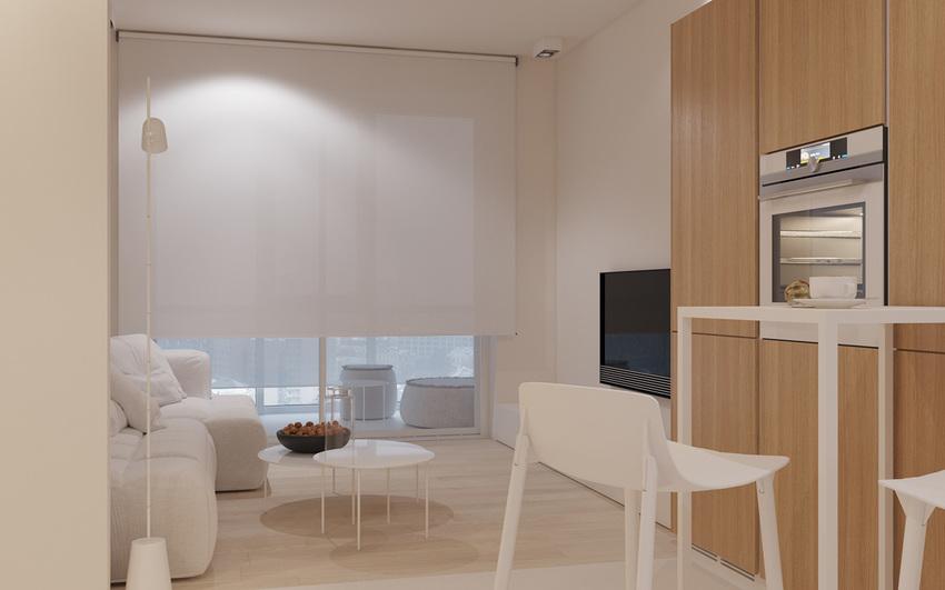 超大窗户用全尺寸的下拉式遮光罩进行装饰,以便在白天也可以很好地观看电视。