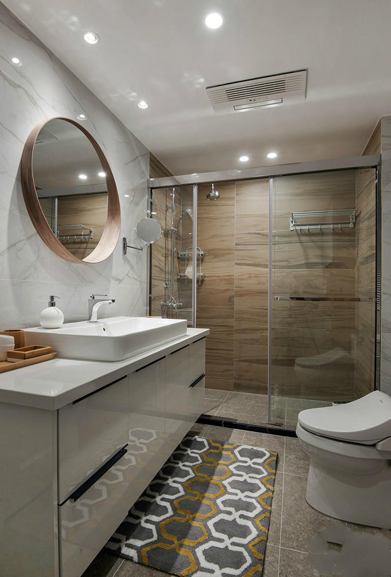 卫生间的墙面以白色为主,搭配小巧的白色洗手台,简约而精致