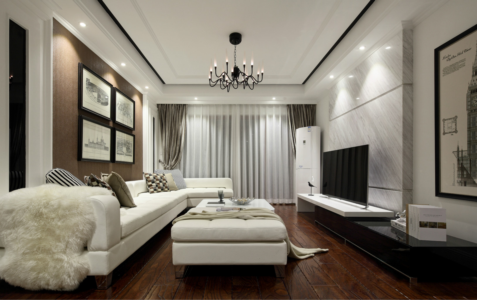 客厅灰白色为主色调,精简的家具,布置了懒人沙发,躺在沙发上看电视十分惬意。