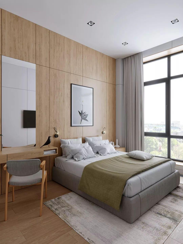 卧室的床头背景墙与地板均用温润木质材质。床边梳妆台搭配水银镜使用,还能作为书桌,方便办公。